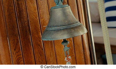 Ship yacht bell wooden background