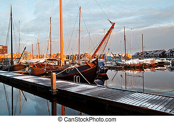 ship, yachts and boast on marina in Groningen, Netherlands