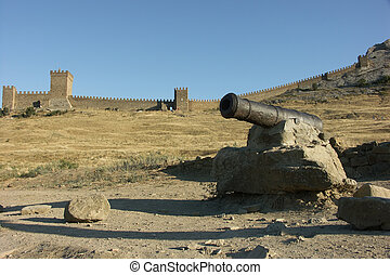 Shipboard cannon on the background of the ancient Genoese ...