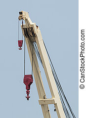 Shipboard crane with two hooks of different sizes