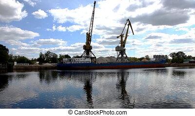 shipboard cranes and sailing boat