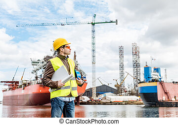 Shipbuilding engineer at the dock side in a port.