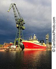 Dark rain clouds over the Gdansk Shipyard, Poland.