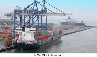 Shipment of cargo in containers to barge by huge crane