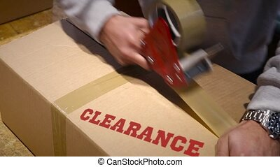 Shipment of clearance items - Production worker sealing...