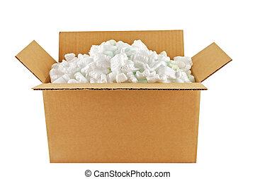 Cardboard shipping carton full of styrofoam peanuts.