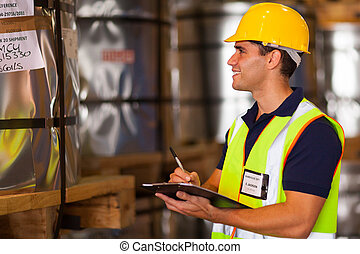 shipping company worker recording steel rolls - shipping...