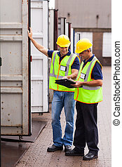 shipping company workers recording containers