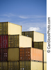 shipping containers against blue sky