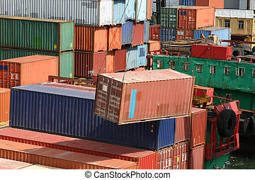 shipping containers being loaded at a port