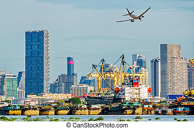 Shipping port and freight cargo plane in transport and import-export commercial logistic ,shipping business industry concept