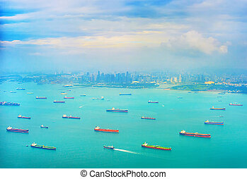 Shipping tankers in Singapore harbor