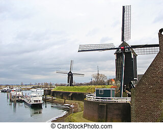 Ships and windmills in the port city Heusden. Netherlands