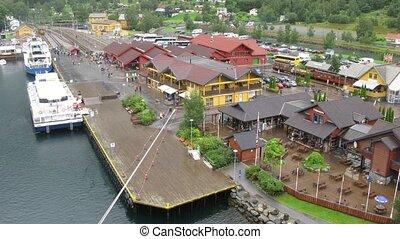 Ships at pier in little Norwegian village