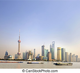 Ships at sunset on the Huangpu River in Shanghai,China. At...