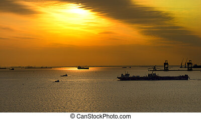 Ships at sunset on the sea