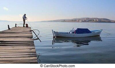 Ships boy knotting rope on a boat. - Ships boy knotting rope...