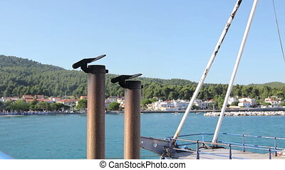 Ship's exhaust pipe with metal cover - View of the fishing...