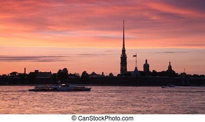 Ships float in front of Peter and Paul Fortress on Neva River