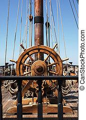 ship's helm / captain's wheel on a tall sailing ship