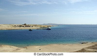 Ships in bay. Beatiful seascape in egyptian desert. Red sea, Egypt, Africa.