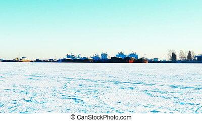 Ships in Port on Frozen Lake in Winter