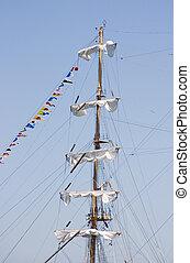 The mast of a sailing ship.