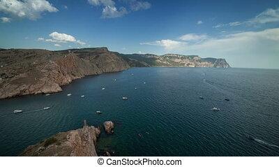 Ships move along the seashore. Timelapse. Crimea. Russia