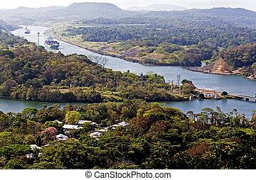 Ships navigate the Panama canal - Large ships navigate the...