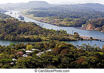 Ships navigate the Panama canal - Large ships navigate the...