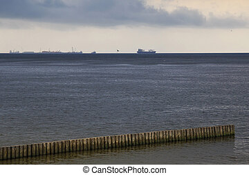 Ships on the Baltic Sea in overcast weather.