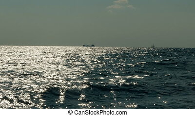 Ships on the horizon of the sea - Easy marine breeze in...