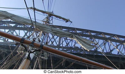 Ship's sail and bridge shot - A worms eye view shot of the...