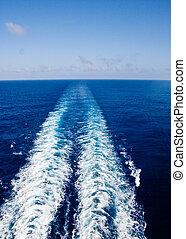 Ships Wake - A ship's wake across a deep blue sea toward ...