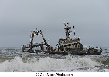 Shipwreck at the Skelleton Coast (Namibia) during a stormy...