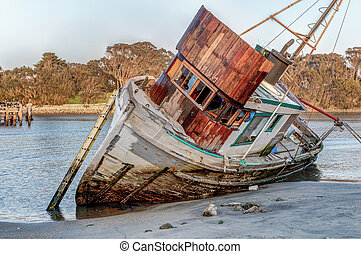 Shipwreck Awash on Beach - Shipwrecked Vessel Washed Ashore ...