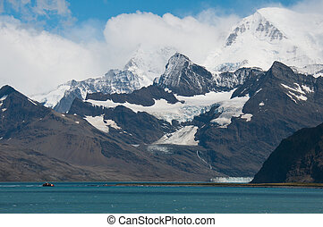 Shipwreck in Antarctica - Majestic mountains covered with...