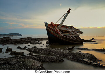 Shipwreck in sunset.
