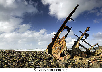 Shipwreck on beach at low tide