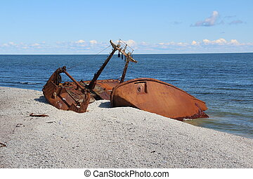 Shipwreck - Rusty wrecked ship on the coast of the island...