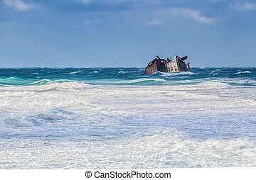 Shipwreck - Storm. Part wreck ejected surf on the beach