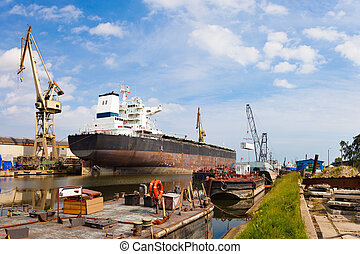 Ship moored at the quay in shipyard of Gdansk, Poland.