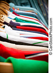 Shirt rack at market - A rack of second-hand shirts and t-...