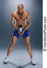 Shirtless Athletic Young Man Holding Water Bottle
