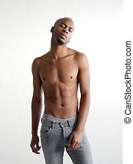Shirtless black man posing on white background