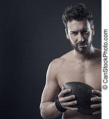Shirtless football player with ball