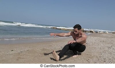 shirtless guy doing one leg squat exercise