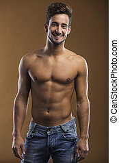 Shirtless male smiling - Shirtless male model smiling to the...