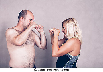 Shirtless man and woman going to fighting
