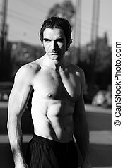 Shirtless man - Outdoor black and white portrait of a hunky...